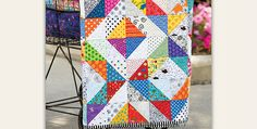 A Great Stash Buster! Dig into your scrap bag and stash and pull out all the fun fabrics for this delightful quilt. Polka dots, florals and stripes in bright colors combine to make a happy quilt that will brighten whatever room it's used in. Black and white background patches provide beautiful contrast for the vivid …