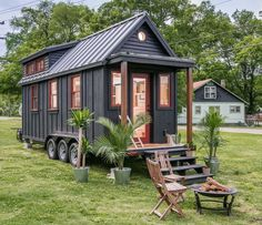This is the Riverside Tiny House. It's built by New Frontier Tiny Homes in Nashville, Tennessee. The home features 246-square-feet of space and is built on a triple-axle utility trailer. Plea…