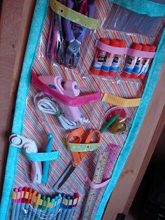 I am not kidding, I am making this one day really soon.  I need a space for all of my craft crap!  A girl and a glue gun: craft organizer