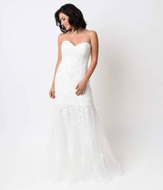 This breathtaking off white lace gown is outfitted with stunning ornate lace embroidery over gauzy tulle, complete in a strapless fitted silhouette. A sweetheart neckline is padded and outfitted with flexible boning and inner gripper binding, fitted to th