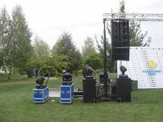 outdoor event with flight cases and lighting truss