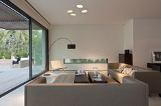 Private house in Israel. Arch floor lamp Fog TE A, designed by Andrea Lazzari And Massimo Tonetto.