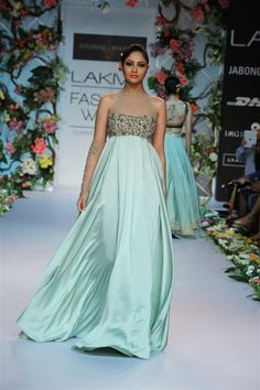 a lovely dusty green satin flared maxi with a halter bodice, delicately embroidered with a rose-gold zardozi