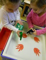 Preschool Playbook: fire prevention - spraying out the fire with spray water bottles.
