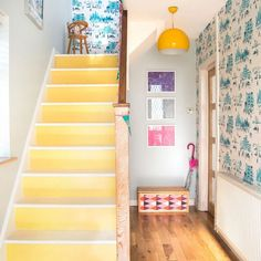 Modern hallway pictures and photos for your next decorating project. Find inspiration from of beautiful living room images Yellow Hallway, Yellow Stairs, Bright Hallway, Hallway Colours, Modern Hallway, Long Hallway, Entry Hallway, Painted Staircases, Painted Stairs