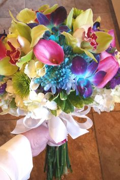 Full of orchids, cush poms, Kermit poms, calla lilies, and hydrangea. Summer Wedding Bouquets, Calla Lilies, Town And Country, Kermit, Hydrangea, Orchids, Floral Wreath, Lily, Wreaths