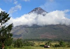 The Mayon volcano in the Phiilippines. The local tourist industry was expecting its latest stirrings to promote a mini-boom. Photograph: Charism Sayat/AFP/Getty Images - See more at: http://news.socialdashboard.com/philippines-orders-evacuation-as-mayon-volcano-threatens-to-erupt/#sthash.IdMQGXRB.dpuf