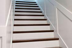 Pretty white trim with dark wood treads  IHeart Organizing: Secret Stairs: No Longer a Secret!