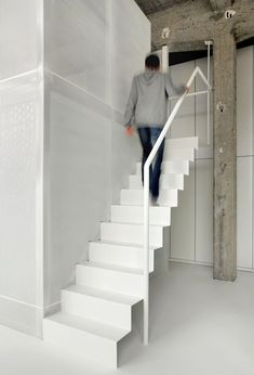 Apart from some typical yet totally cool features, like the exposed concrete ceiling and massive garage style windows, this loft design idea by Belgian Steel Stairs, Loft Stairs, House Stairs, Architecture Journal, Modern Architecture, Modern Staircase, Staircase Design, Escalier Design, Style Loft