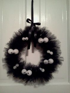 Halloween wreath made using a wire hanger as the base and one 25-yard roll of tulle cut into short pieces and tied to the hanger.  Eyes are 1-inch and 1.5-inch styrofoam balls with 1 cm and 1.2 cm google eyes glued on.  Tie a ribbon to the top as decorative hanger and enjoy your cute and super easy wreath. Halloween costumes Halloween decorations Halloween food Halloween ideas Halloween costumes couples Halloween from brit + co Halloween