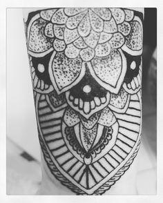 Mandala Henna style tattoo.