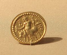 Coin of Vasudeva Date: 185–220 Culture: Pakistan (ancient region of Gandhara) Medium: Gold. The Great Kushan rulers minted these gold coins in the second and early third centuries. They follow a Roman weight standard, and the rulers present themselves in relation to a range of Near Eastern and South Asian deities, such as the Shiva on the reverse of Vasudeva's coin.
