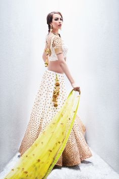 Sangeet Lehengas - White and Yellow Lehenga | WedMeGood | White Choli and Lehenga with Scattered Broze Sequin Work with a Yellow Dupatta and Gold and Yellow Latkans Outfit by Sue Mue #wedmegood #lehengs #indianbride #indianwedding #yellow #white