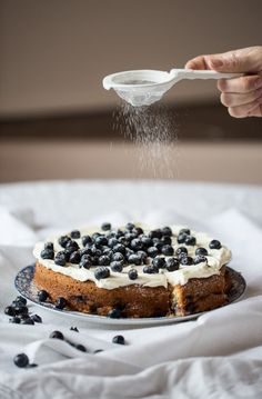 Lemon  Blueberry Cake with lemon cream cheese frosting in honor of National Blueberry Month