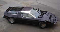 crazyforcars:  Love the stainless steel roof panel, especially with the dark paint
