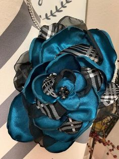 Checked Teal - circle flower pin by Pins Of Grace Fabric Flower Brooch, Fabric Flowers, Blue Grey, Teal, Black Felt, White Plaid, Silver Beads, Baby Car Seats, Going Out