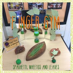 Jack and the beanstalk inspired Finger Gym. Green spaghetti in the dough. Carefully place the leaves and wheetos to build a beanstalk.