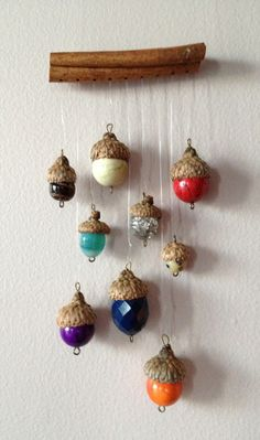 Acorn caps with beads strung from a cinnamon stick! Makes a lovely sun catcher.
