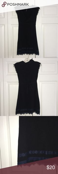 Free People Lace Tunic Black tunic with blue lace, only worn once, size medium, ties in the back Dresses