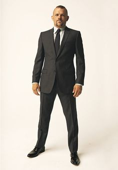 The 5 Tips Every Athletic Man Should Know  1) A solid build doesn't mean your suit should be a size too large.  2) Two-button jackets sync up with the V shape of your torso.  3) Low-collar shirts work well with a thicker neck.  4) Your jacket will likely need to be taken in at the sides.  5) Yes, you can wear narrow-cut trousers. It's your chest that needs room, not your ankles.