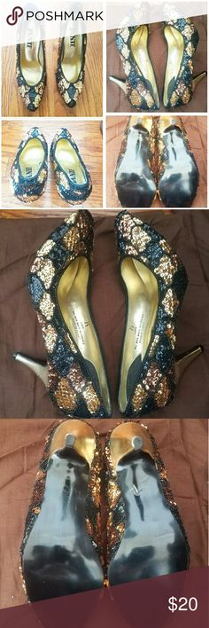 Sequin Heels These Sequin Black, Gold, brown pump heels are a size 7 1/2, made in China and ARE in excellent condition. Never been worn by looking at the bottom of the shoe. Janie Shoes Heels