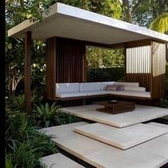 Modern Gazebo With Steps And Sofa Benches And Small Wooden Coffee Table , Beautiful Modern Gazebo Application for Front Yard or Backyard Garden Decor In Uncategorized Category