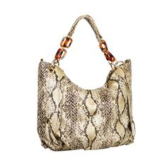 Reese Witherspoon has been spotted in LA sporting an elegant snakeskin handbag.