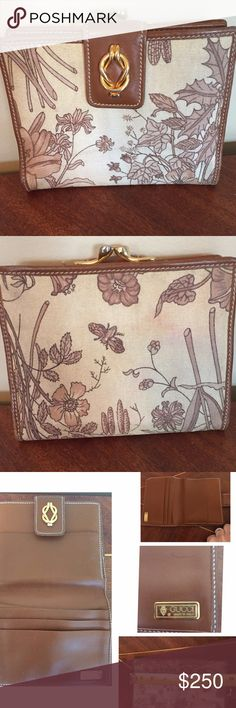 "Authentic Vintage Gucci Floral Wallet Super Rare Accessory From Gucci. Early 1980's. This is part of my mother's collection. Authentic. Monotone sepia brown. Made out of Canvas & Leather. See All Photos For Information & Ask Questions! Measurements are appropriately 5""L X 4""W .This is Gently Used item with some wear and markings to the leather trim, the canvas material has some stains and discolorations, and the inside has little wear and markings.Purse & Coin Bag listed Separate. NO…"