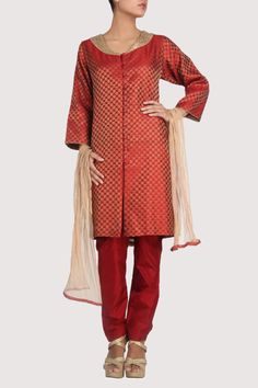 Red toned brocade suit featuring spiral patterns woven all over. Shop Now: www.karmik.in/shopping/index.php