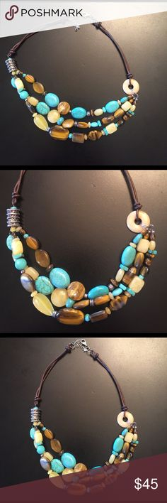 Silpada Necklace Cute Silpada Stabilized Turquoise and Tiger's eye Necklace with brown leather chain.  Worn about 3 or 4 times. Good condition / like new. Silpada Jewelry Necklaces