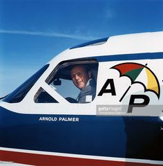 Arnold Palmer peers out the window of his personal airplane around 1965 in Latrobe, Pennsylvania.
