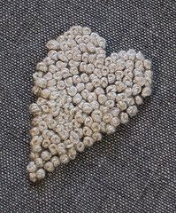 french knots  or sew seed pearls onto fabric in shape of a heart add pin back or earring clip to put on necklace
