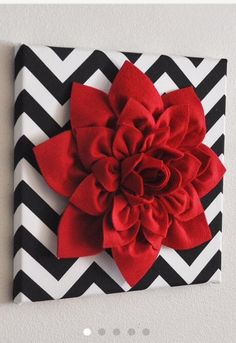 Fabric covered canvas with felt flower (need to find tutorial on how to make flower though)