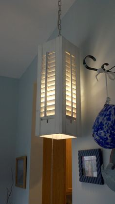 Great idea for old shutters. Can point the light up or down depending on what you need highlighted. Definitely going to try this. Might even try outdoor lanterns with this idea.
