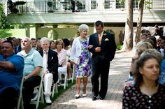 An Orange & Purple Wedding: The Groom's Grandma is escorted down the aisle by the Groom's brother. http://linnealizphotography.com