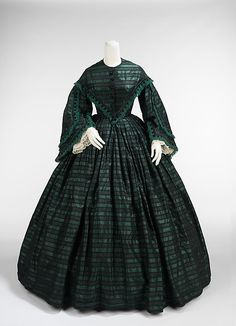 Walking dress Date: ca. 1865 Culture: American Medium: silk Dimensions: Length at CB (a): 16 in. (40.6 cm) Length at CB (b): 47 in. (119.4 cm) Credit Line: Brooklyn Museum Costume Collection at The Metropolitan Museum of Art, Gift of the Brooklyn Museum, 2009; Gift of The Jason and Peggy Westerfield Collection, 1969 Accession Number: 2009.300.3336a, b