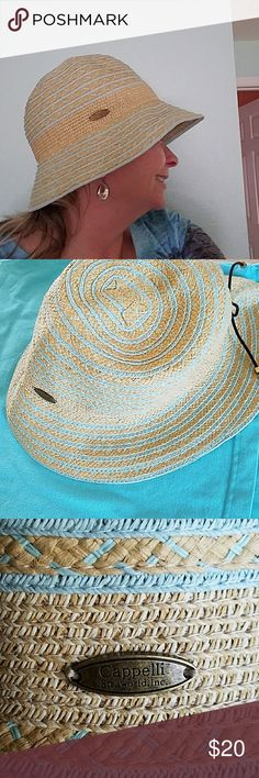 Cappelli Straworld hat Worn once. Paper/polyester cloche style hat. Lovely straw color with aqua blue striping. Brown cord makes this hat adjustable.  *Bundle and Save* **Make an offer** Cappelli  Accessories Hats