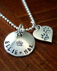 Pet Lovers Name Necklace Personalized pet name necklace for the animal lover in your life to honor their beloved furry friend.    Pet jewelry, paw print, cat lover necklace, animal lover gift, dog lover necklace.  Sterling silver, hand stamped necklace.  Paw print charm measures 15mm.  Circle charm stamped with paw print measures 7/8″- personalize with up to 18 characters.