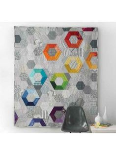 Patchwork quilting pattern with glimpses of color | InterweaveStore.com