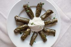 This meze of stuffed grape leaves is served with a cucumber-yogurt sauce.