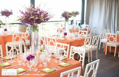 Orange table cloths with purple tall centerpieces. Perfect for this purple and orange color scheme! @carolinetran #bright