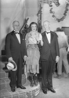 5/14/31-Montana: Both Kansas City and St. Louis claim vivacious Ginger Rogers, star of 'Girl Crazy' as their own--so what's a poor girl to do? Ginger is a diplomatic Miss and insists she belongs to the country at large. Left to right, backstage at the Alvin Theatre in New York: Mayor Bryce B. Smith, Ginger Rogers and Mayor Victor J. Miller.