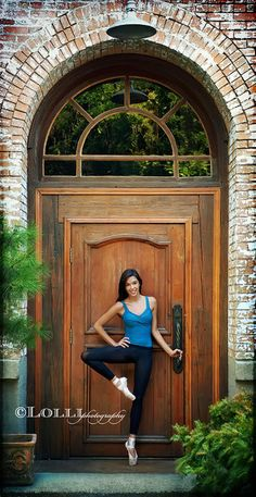 Love this door...not just that it is grand, but love the coloration of the door, the moulding, the hardware, the window above and the brick surrounding.  It is great texture and dimension. So great!