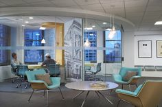 Pandora's office in Chicago with Herman Miller Swoop chairs and Eames Management chairs.