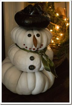 Snowman made from pumpkins left over from Halloween or Thanksgiving!