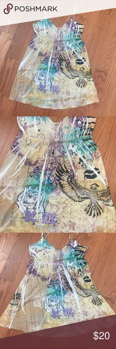 Justified tank top eagle flower tan Justified tank top has eagle lips butterflies stars flowers boemi colors are teal green black white lavender beautiful top tag removed on inside that says size it is a size small very stretchy. Slinky polyester material justified Tops Tank Tops