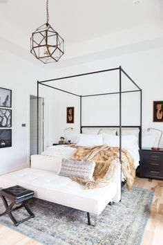 5 Tips for Creating A Master Bedroom He Will Love - Master bedroom design canopy beds fur throw gallery walls pendant light fixture in master bedroom master bedroom lighting master bedroom light Farmhouse Master Bedroom, Master Bedroom Design, Dream Bedroom, Home Decor Bedroom, Bedroom Furniture, Bedroom Ideas, Master Suite, Light Bedroom, Bedroom Designs