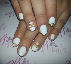 White and gold nails evil eye detail