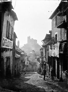 Najac, street and castle-Eugène Trutat 1889  Najac is a commune in the Aveyron department in southern France. a picturesque village set along a ridge above a bend in the Aveyron River. In the earlier part of the last century the village had around 2000 people but it suffered marked population decline as workers migrated to towns and cities. Several films concern the village and its surrounds, for example, La Vie Comme Elle Va.