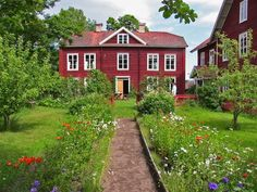 Traditional farmhouse and garden in Hälsningland, Sweden. (Hälsingegård)